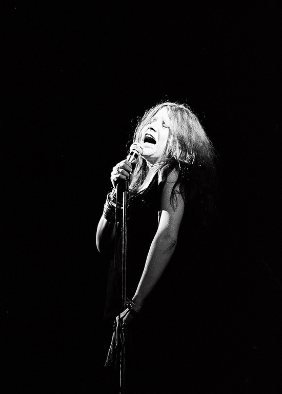 """. * ADVANCE FOR WEEKEND EDITIONS, JUNE 16-19 **In this photo provided by Fenton Communications from Feb. 11, 1969, taken by photographer David Fenton, Janis Joplin performs at the Fillmore East in New York. In a newly released compilation, \""""Shots: An American Photographer\'s Journey 1967-1972,\"""" Fenton\'s photos depict the protests, politics and personalities of this turbulent era with a keen eye for detail and a naive fearlessness that comes only with youth.  (AP Photo/David Fenton)"""