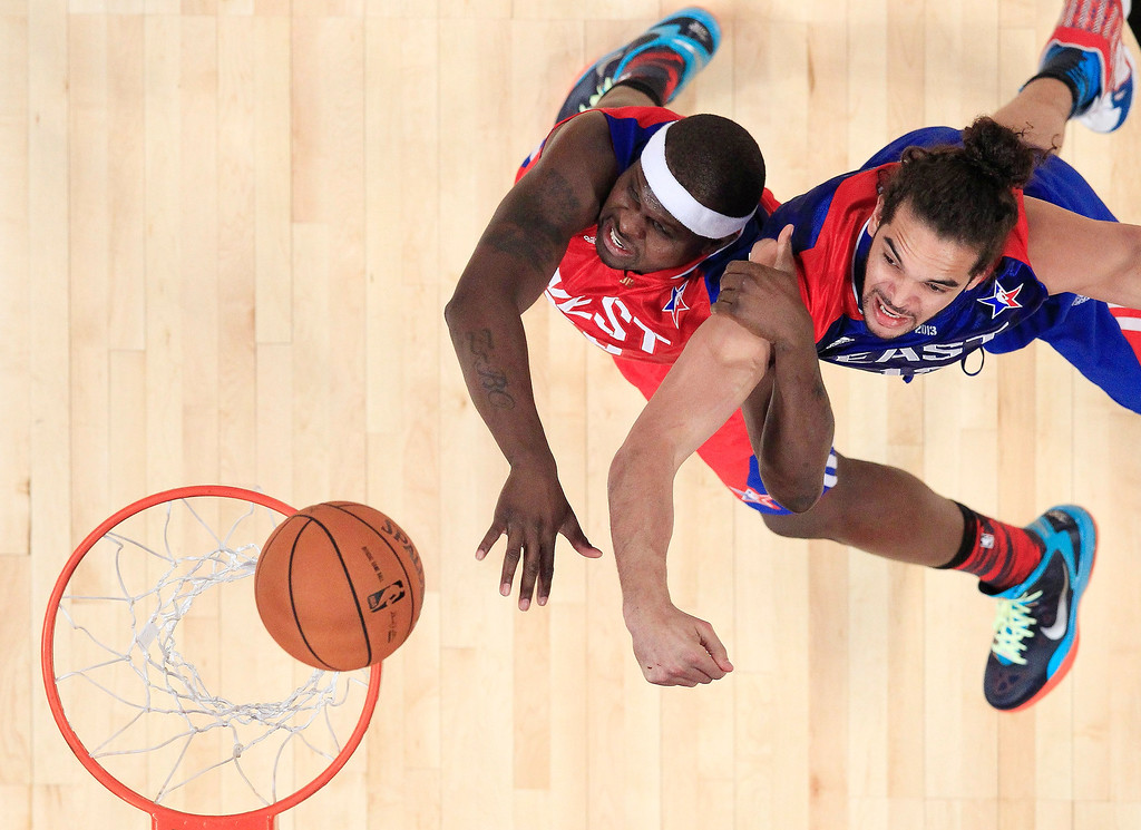 . West Team\'s Zach Randolph of the Memphis Grizzlies and East Team\'s Joakim Noah from France, of the Chicago Bulls go after a loose ball , during the first half of the NBA All-Star basketball game Sunday, Feb. 17, 2013, in Houston. (AP Photo/Lucy Nicholson, Pool)