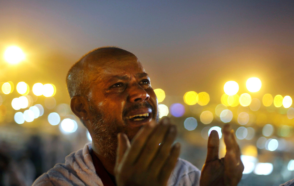 . An Egyptian Muslim pilgrim cries as he prays at sunrise on a rocky hill called the Mountain of Mercy, on the Plain of Arafat near the holy city of Mecca, Saudi Arabia, Monday, Oct. 14, 2013.  (AP Photo/Amr Nabil)