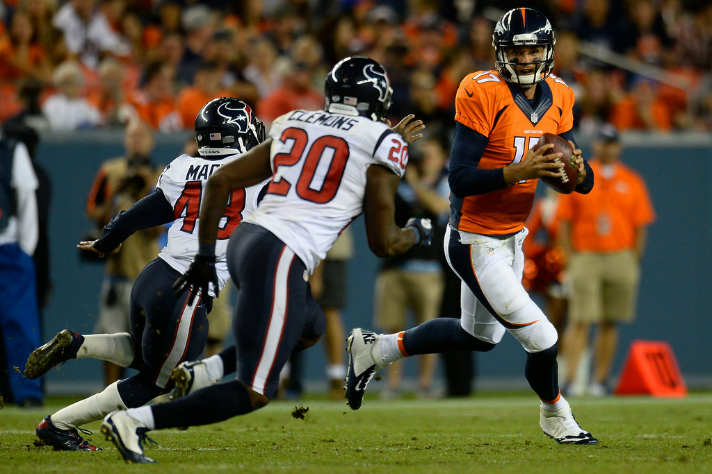 . DENVER, CO - AUGUST 23:  Brock Osweiler (17) of the Denver Broncos scrambles out of the pocket during a preseason football game at Sports Authority Field at Mile High on Saturday, August 23, 2014 in Denver, Colorado.  (Photo by Kent Nishimura/The Denver Post)