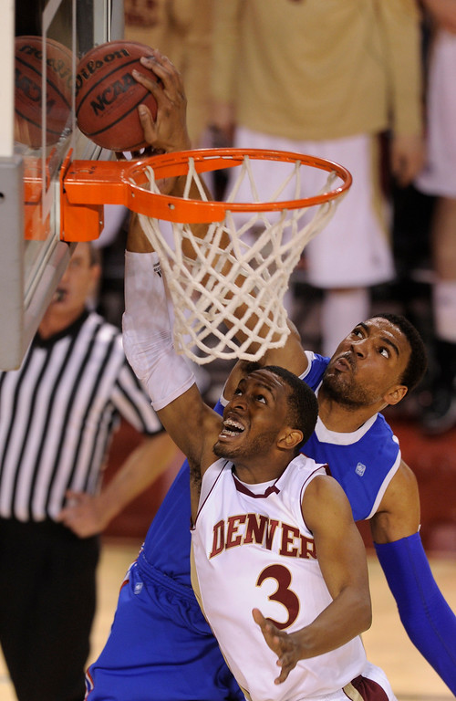 . Bulldogs Brandon Gibson (2) fouled Pioneers guard Jalen Love (3) in the second half. The University of Denver men\'s basketball team defeated the Louisiana Tech Bulldogs 78-54 at Magness Arena Saturday night, March 9, 2013. (Photo By Karl Gehring/The Denver Post)