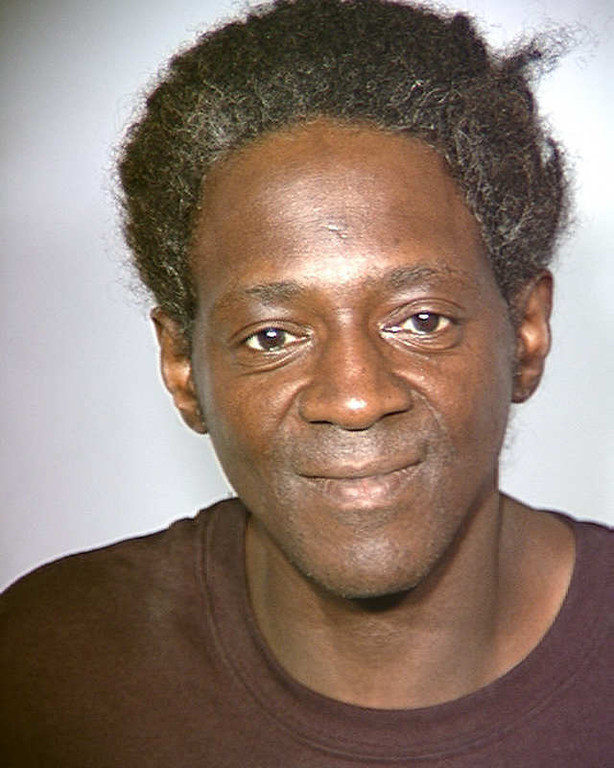 . In this police booking mug released Monday, May 2, 2011 by the Las Vegas Police Department, rapper and reality television star Flavor Flav is shown after his arrest on Friday, April 29, 2011, on four outstanding misdemeanor warrants for driving offenses. The entertainer whose real name is William Jonathan Drayton was arrested Friday night after a traffic stop east of the Las Vegas Strip.  (AP Photo/Las Vegas Police Department)
