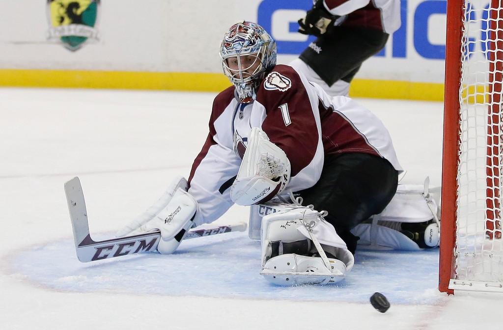 . Colorado Avalanche goalie Semyon Varlamov blocks a shot against the Anaheim Ducks during the second period of an NHL preseason hockey game in Anaheim, Calif., Sunday, Sept. 22, 2013. (AP Photo/Chris Carlson)
