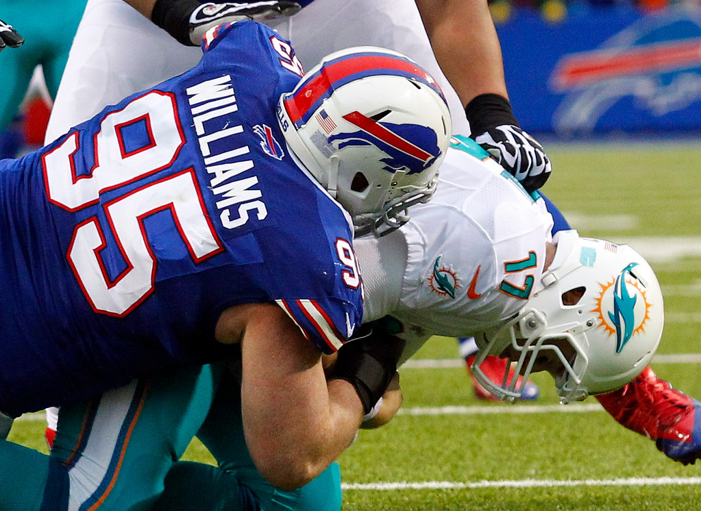 . Buffalo Bills defensive tackle Kyle Williams (95) sacks Miami Dolphins quarterback Ryan Tannehill (17) during the second half of an NFL football game Sunday, Dec. 22, 2013, in Orchard Park, N.Y. Buffalo won 19-0. (AP Photo/Bill Wippert)