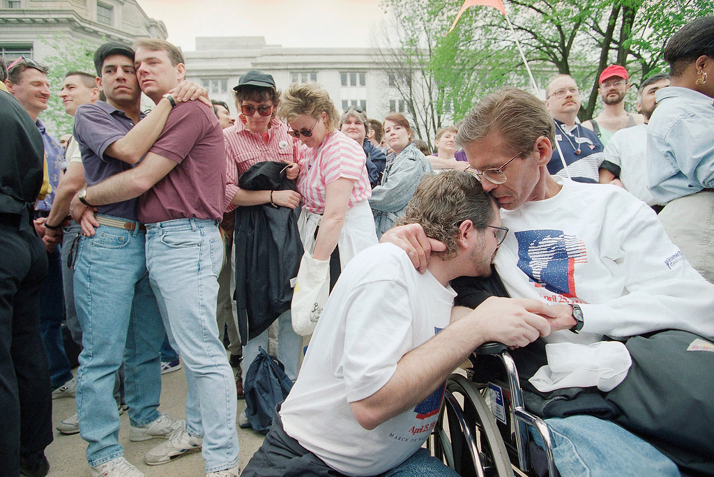 . Marlin Hofer, left foreground, and David Briley, both from Portland, Ore., embrace during a wedding-interfaith ceremony in front of the Internal Revenue Service Building, Saturday, April 24, 1993, Washington, D.C. Hofer is HIV positive and Briley has Aids. This was one of several events leading to Sundays gay rights march. (AP Photo/Wilfredo Lee)
