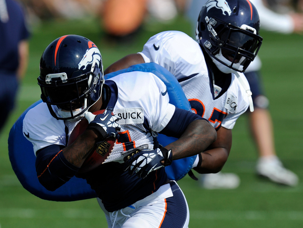 . ENGLEWOOD, CO - JULY 27: Denver Broncos RB, Ronnie Hillman, left, gets past fellow running back, Knowshon Moreno, right, on a running drill during training camp at Dove Valley Saturday July 26, 2013.  (Photo By Andy Cross/The Denver Post)