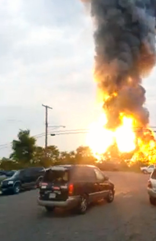 . This still taken from video provided by James LeBrun shows an explosion outside Baltimore on Tuesday, May, 28, 2013.  (AP Photo/James LeBrun)
