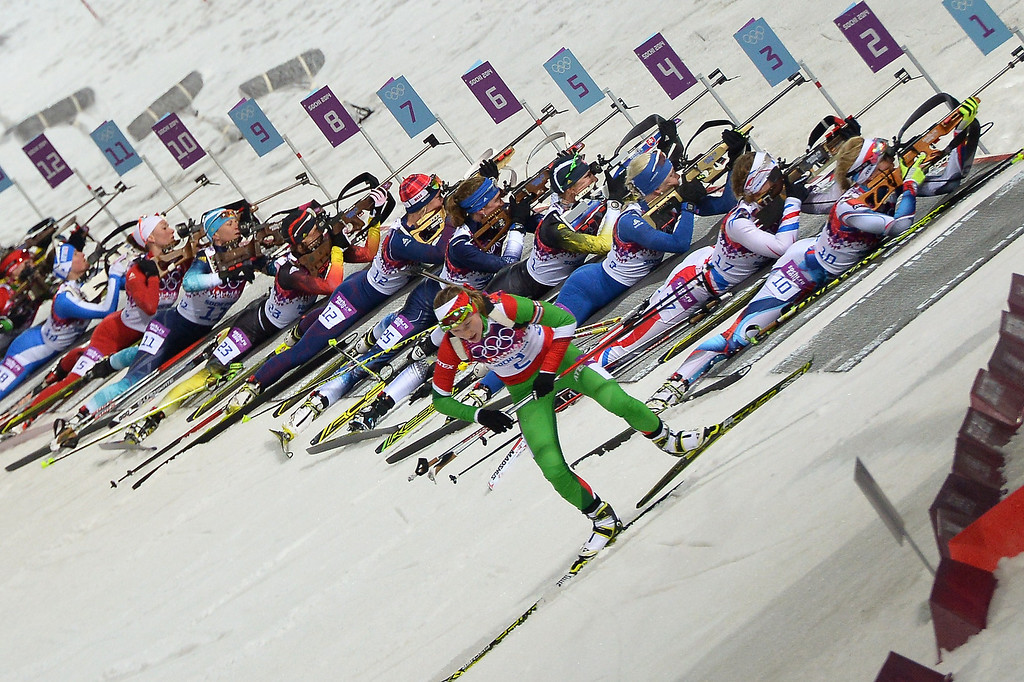 . Belarus\' Darya Domracheva (2) leaves the range as others shoot as they compete in the Women\'s Biathlon 12,5 km Mass Start at the Laura Cross-Country Ski and Biathlon Center during the Sochi Winter Olympics on February 17, 2014, in Rosa Kuthor, near Sochi.  AFP PHOTO / ALBERTO PIZZOLI/AFP/Getty Images