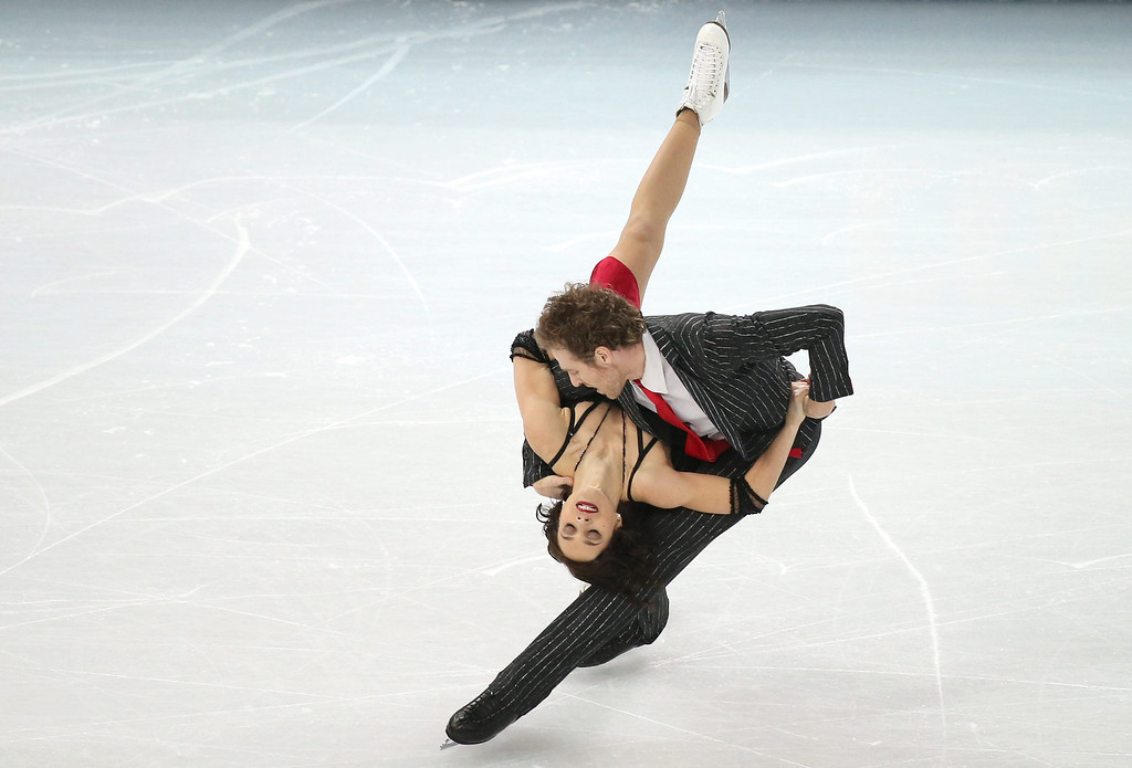 . Nathalie Pechalat and Fabian Bourzat of France perform during the Ice Dance Short Dance of the Figure Skating event at the Iceberg Palace during the Sochi 2014 Olympic Games, Sochi, Russia, 16 February 2014.  EPA/HOW HWEE YOUNG