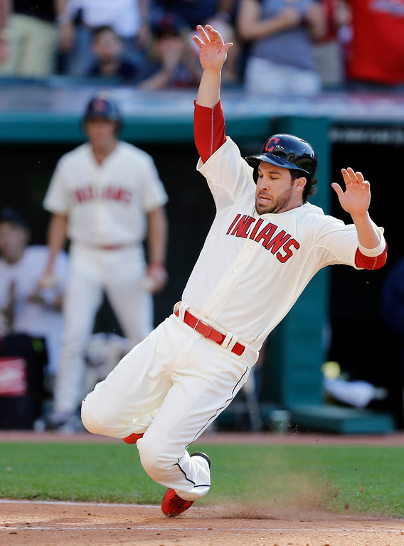 . Cleveland Indians\' Jason Kipnis slides home to score the go ahead run on a single by Mike Aviles in the eighth inning of a baseball game against the Colorado Rockies Saturday, May 31, 2014, in Cleveland. Cleveland held on to win 7-6. (AP Photo/Mark Duncan)
