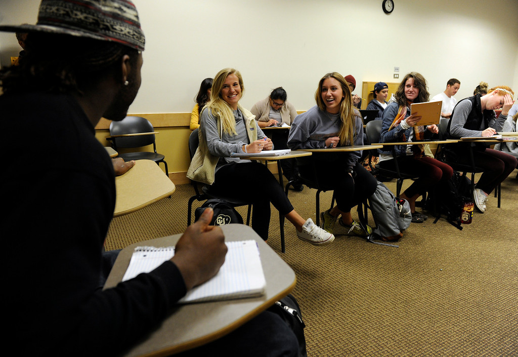 . BOULDER, CO - NOV. 4: Earlier in the semester, senior Derrick Webb, a linebacker for the Colorado Buffaloes football team, chats with classmates before the start of his Women in Sports class on the University of Colorado campus. (Photo By Kathryn Scott Osler/The Denver Post)
