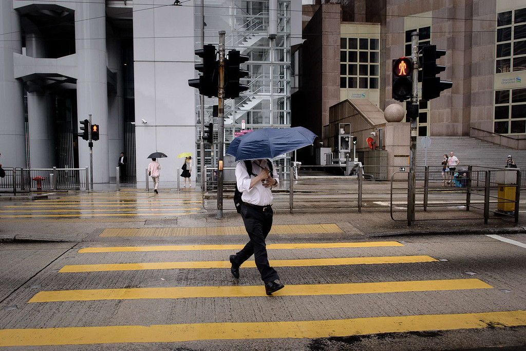 . A man holds his umbrella against heavy winds in Hong Kong on August 13, 2013 as the city braces for deadly Typhoon Utor which earlier swept through the Philippines. The strongest typhoon to hit the Philippines this year caused floods and landslides, killing at least two people as rescuers raced to reach isolated villages in the storm\'s path.   PHILIPPE LOPEZ/AFP/Getty Images