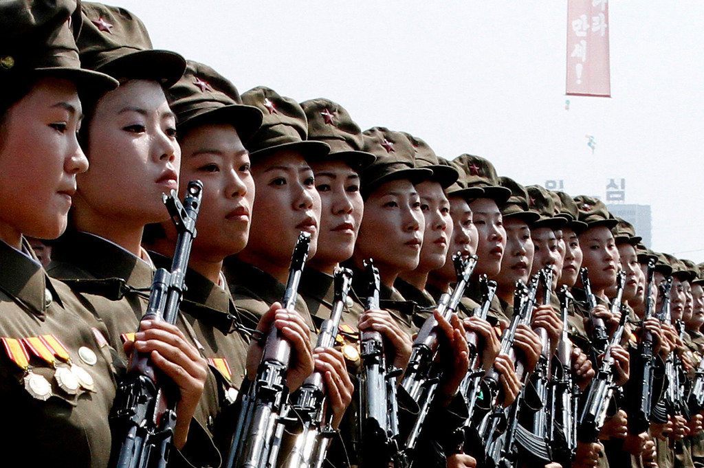 . North Korean female troops march during a military parade at Kim Il Sung Square to mark the 65th anniversary of the country\'s founding in Pyongyang, North Korea, Monday, Sept. 9, 2013. (AP Photo/Kim Kwang Hyon)