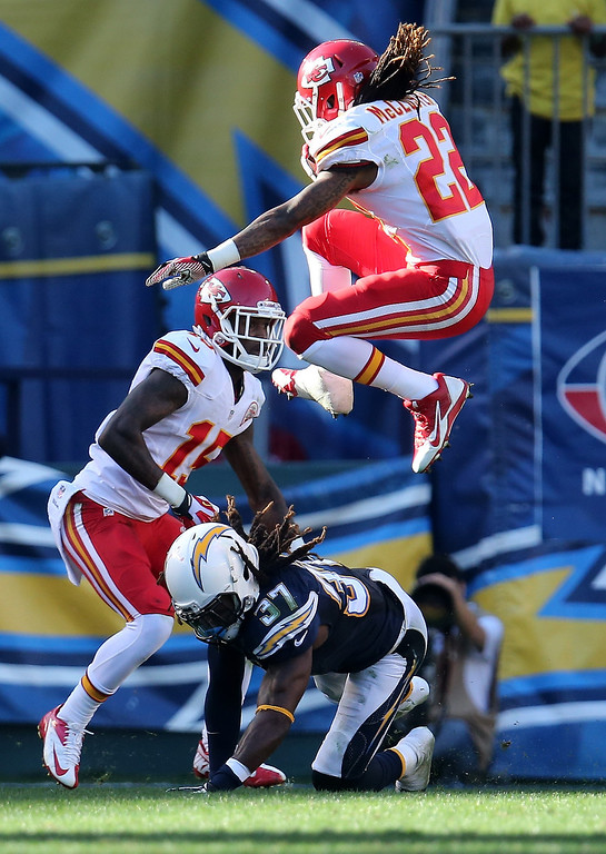 . Wide receiver Dexter McCluster #22 of the Kansas City Chiefs jumps over safety Jahleel Addae #37 of the San Diego Chargers at Qualcomm Stadium on December 29, 2013 in San Diego, California.  (Photo by Stephen Dunn/Getty Images)