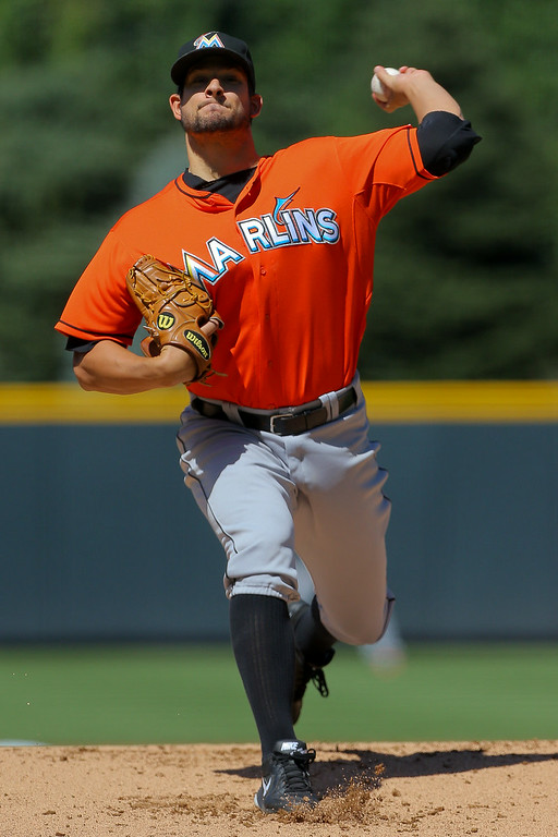 . DENVER, CO - AUGUST 24: Starting pitcher Brad Hand #52 of the Miami Marlins delivers to home plate during the first inning against the Colorado Rockies at Coors Field on August 24, 2014 in Denver, Colorado. (Photo by Justin Edmonds/Getty Images)