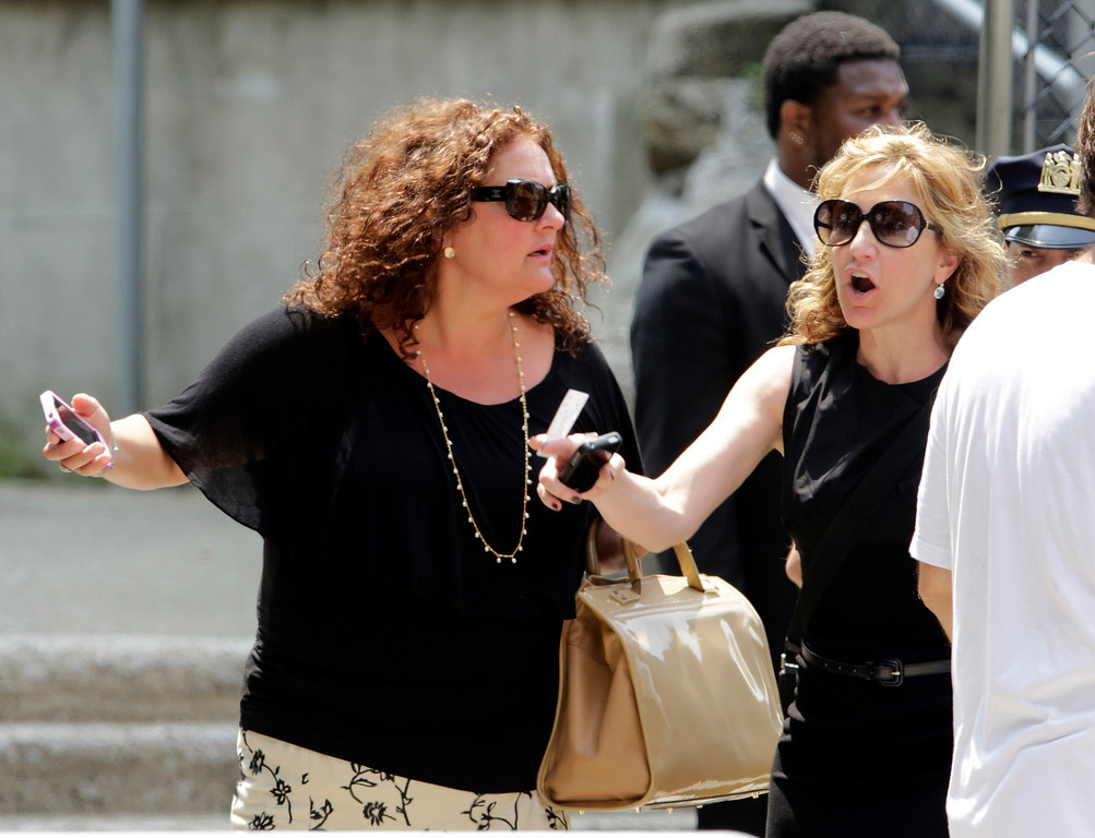 ". Actresses Aida Turturro, left, and Edie Falco, leave the funeral service of James Gandolfini, star of ""The Sopranos,\"" in New York\'s the Cathedral Church of Saint John the Divine,  Thursday, June 27, 2013. (AP Photo/Richard Drew)"