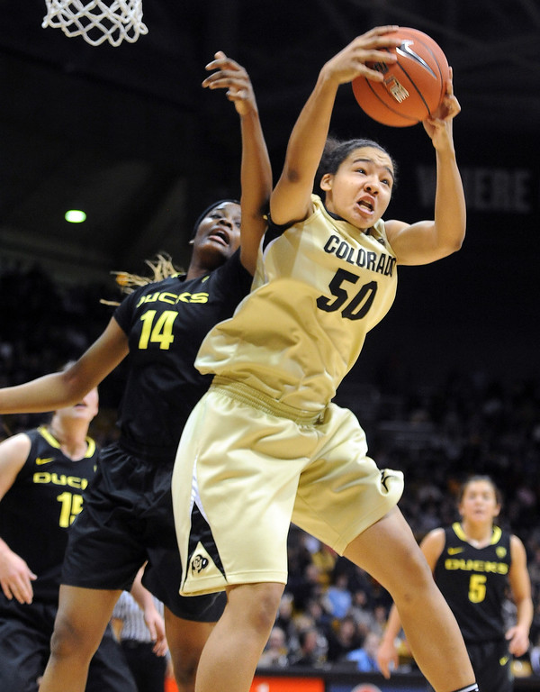 . Jamee Swan of CU gets an offensive rebound over Jillian Alleyne of Oregon. Cliff Grassmick / February 10, 2013