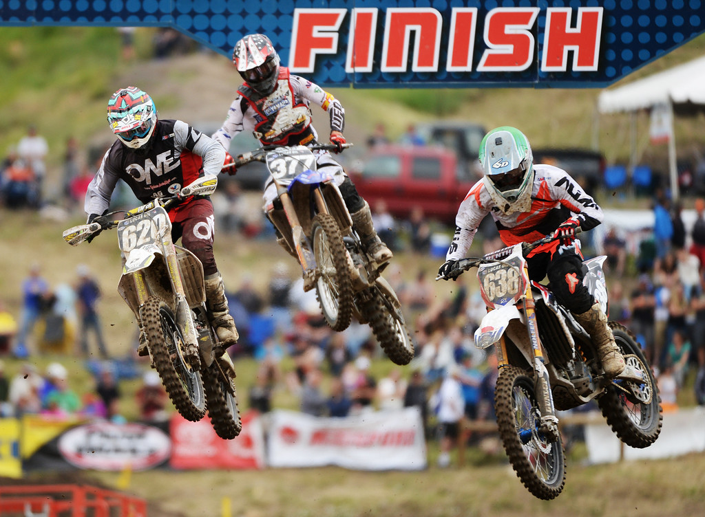 . From left, Brad Nauditt (620), Christophe Pourcel (377) and Brandan Leith (638) are competing 250 Class Moto #1 in the mile high altitude of Thunder Valley MX Park for the third round of the Lucas Oil Pro Motocross Championship. Lakewood, Colorado. June 07. 2014. (Photo by Hyoung Chang/The Denver Post)