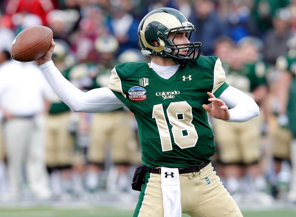 . Colorado State quarterback Garrett Grayson (18) throws during the first half of the NCAA New Mexico Bowl college football game against Washington State, Saturday, Dec. 21, 2013, in Albuquerque, N.M. (AP Photo/Matt York)