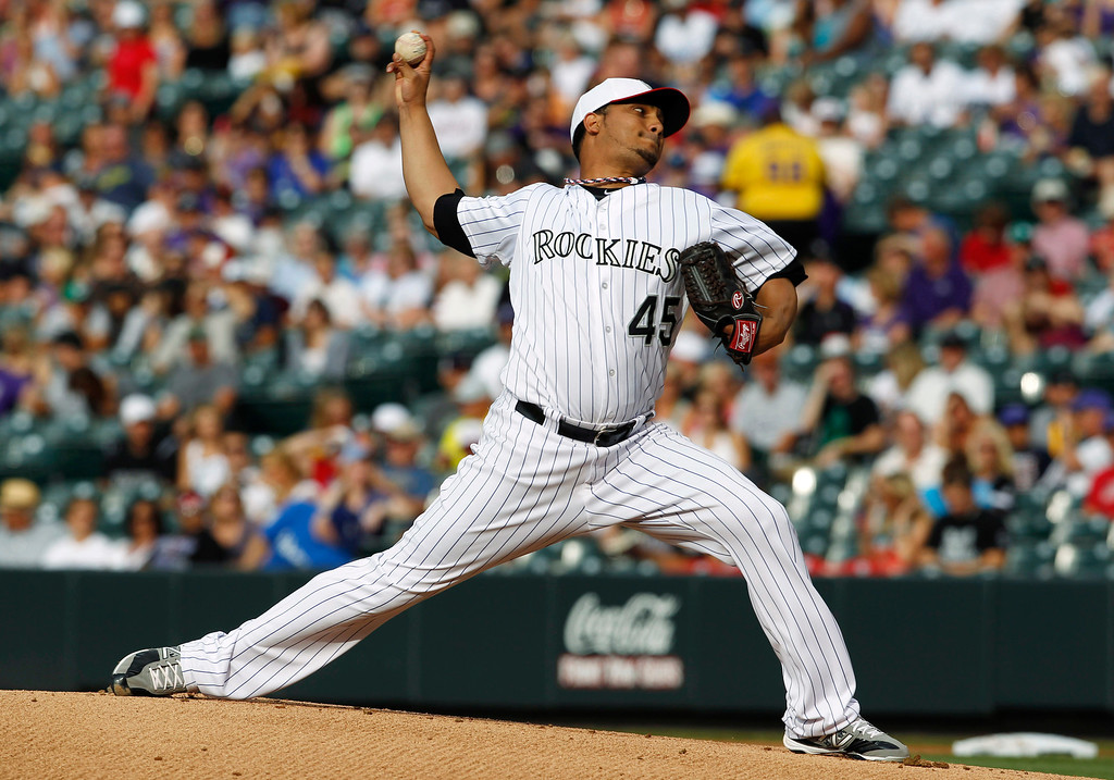 . Colorado Rockies starting pitcher Jhoulys Chacin works against the Los Angeles Dodgers in the first inning of a baseball game in Denver on Thursday, July 4, 2013. (AP Photo/David Zalubowski)