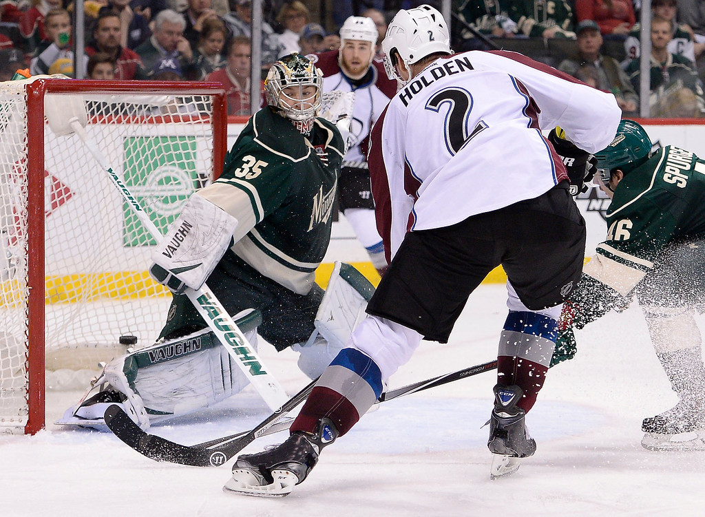 . Colorado Avalanche defenseman Nick Holden (2) hits the back of the net for a goal on Minnesota Wild goalie Darcy Kuemper (35) during the second period April 28, 2014 in Game 6 of the Stanley Cup Playoffs at Xcel Energy Center.  (Photo by John Leyba/The Denver Post)