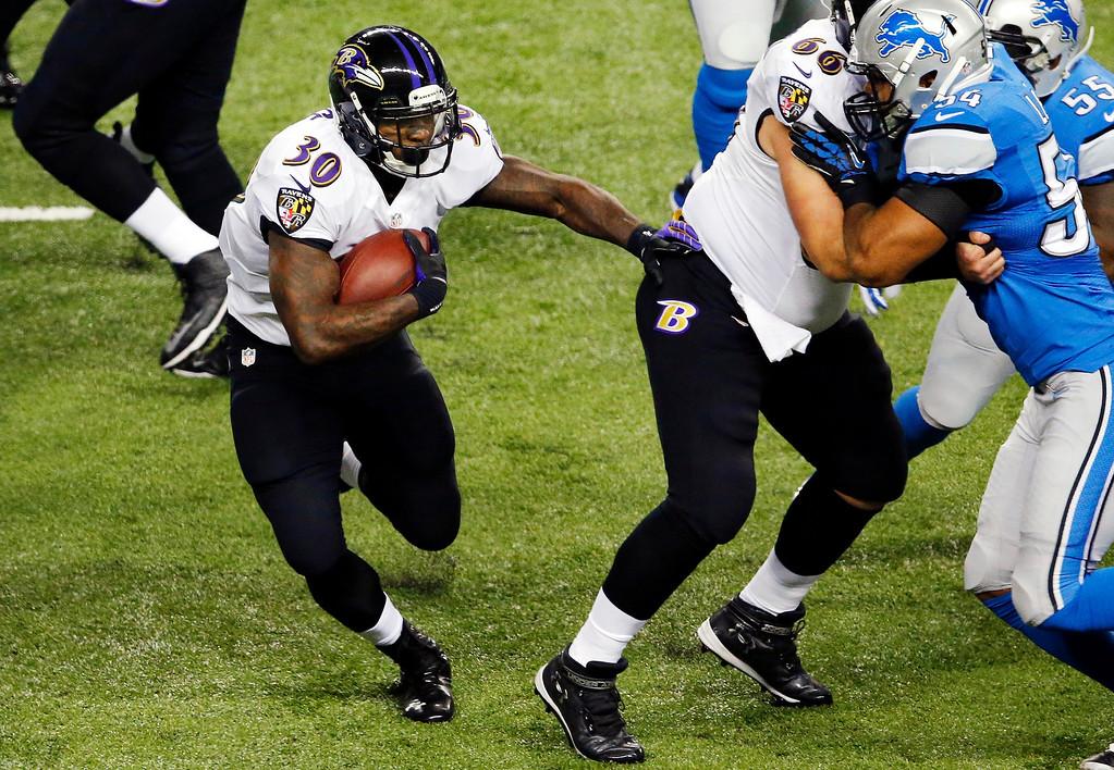 . Baltimore Ravens running back Bernard Pierce (30) runs during the first half of an NFL football game against the Detroit Lions in Detroit, Monday, Dec. 16, 2013. (AP Photo/Paul Sancya)