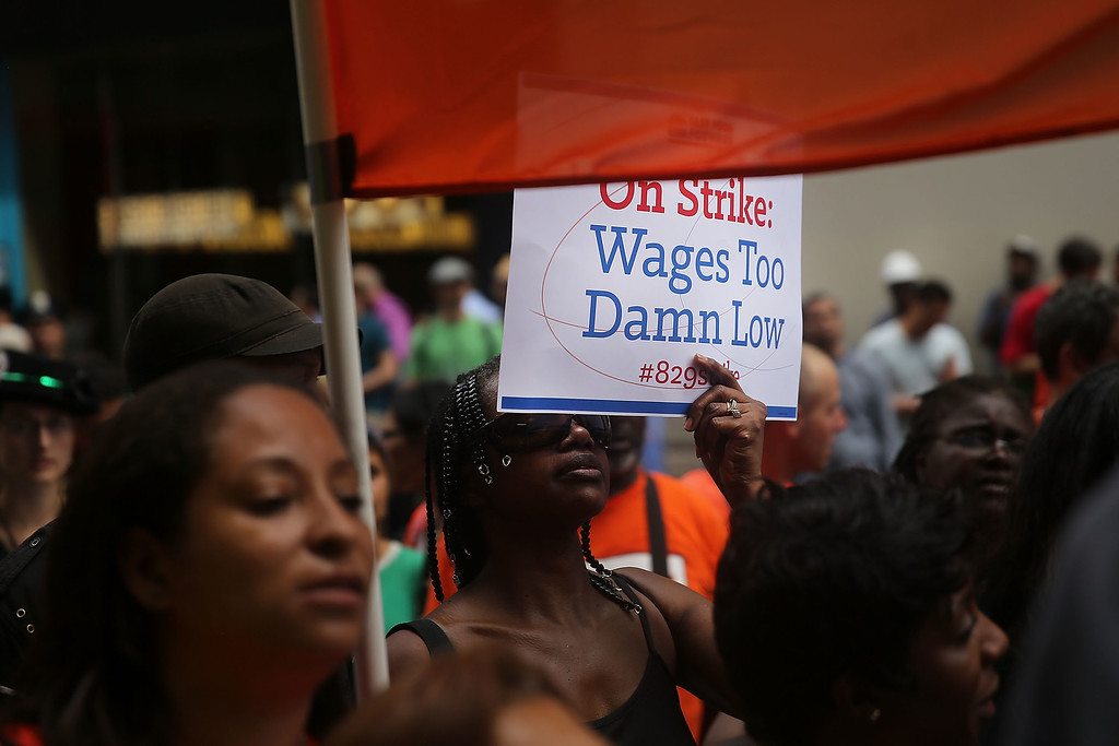 . Employees and supporters demonstrate outside of a Wendy\'s and Burger King fast-food restaurants to demand higher pay and the right to form a union on August 29, 2013 in New York City.   (Photo by Spencer Platt/Getty Images)