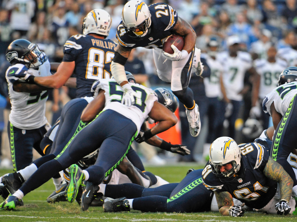 . San Diego Chargers running back Ryan Mathews sails over the Seattle Seahawks defense for a first down in the first quarter of an NFL preseason football game Thursday, Aug. 8, 2013, in San Diego. (AP Photo/Denis Poroy)