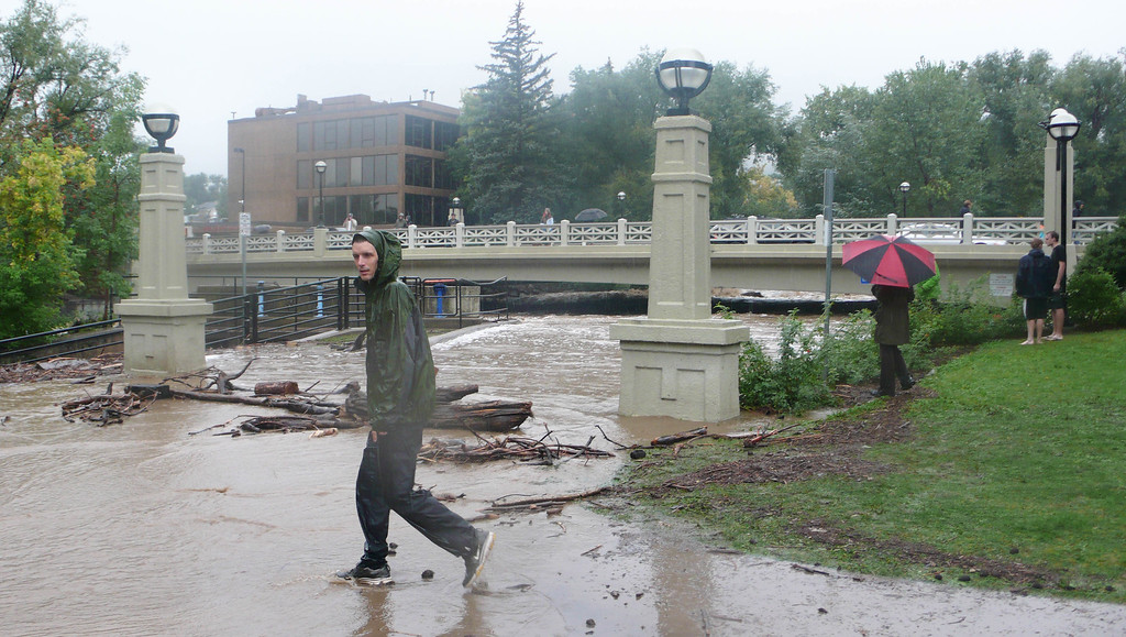 . Boulder Creek, flowing under the Broadway Bridge in downtown Boulder, at between 4,500 cfps and 5,370 cfps, on Thursday, September 12. By 6pm Thursday Boulder had received 9.08 inches. (Photo by David Bjorkman-EPF)