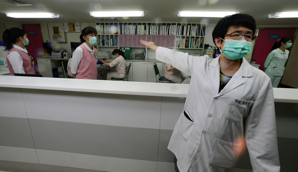 . A nurse (R) introduces the front desk for the negative pressure isolation rooms section, which will be used to treat potential H7N9 avian influenza patients, at Taipei Hoping Hospital on April 6, 2013.  Taiwan enhanced its level of alert against bird flu and set up a contingency centre on April 3 after reports in mainland China of new infections from a new strain of avian influenza. The new infections alarmed the authorities in Taiwan, which is separated from the Chinese mainland only by a 180-kilometre (111.6 miles) strait and which has seen a dramatic influx of 2.6 million Chinese visitors last year due to the fast warming ties between Taipei and Beijing.       SAM YEH/AFP/Getty Images
