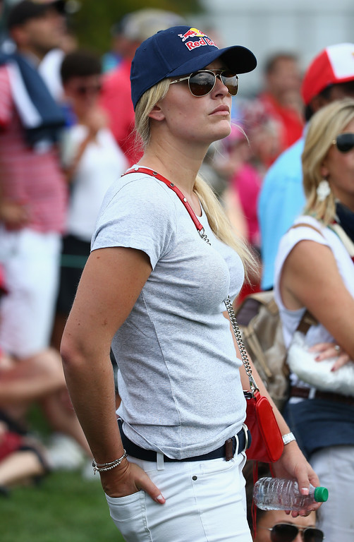 . DUBLIN, OH - OCTOBER 05:  Olympic skiier Lindsey Vonn watches the play of Tiger Woods of the U.S. Team during the Day Three Four-ball Matches at the Muirfield Village Golf Club on October 5, 2013  in Dublin, Ohio.  (Photo by Andy Lyons/Getty Images)