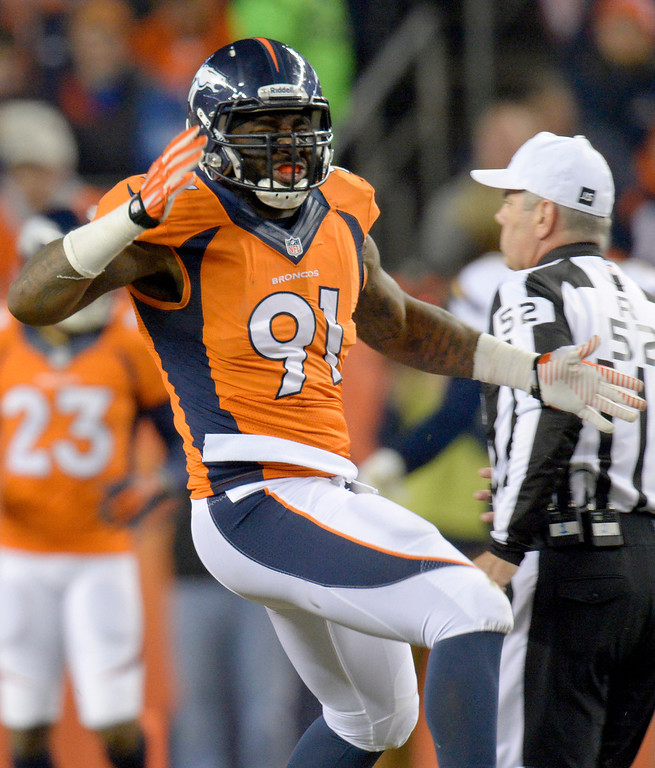 . Denver Broncos defensive end Robert Ayers (91) celebrates stopping the San Diego Chargers during the second quarter. The Denver Broncos vs. the San Diego Chargers at Sports Authority Field at Mile High in Denver on December 12, 2013. (Photo by John Leyba/The Denver Post)