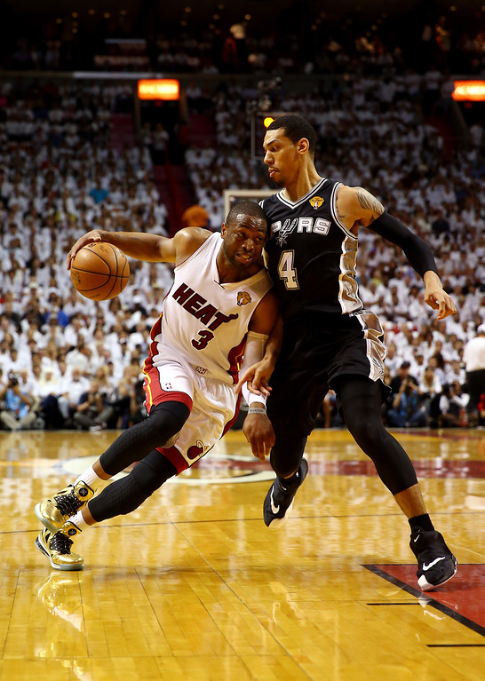 . MIAMI, FL - JUNE 12:  Dwyane Wade #3 of the Miami Heat drives to the basket against Danny Green #4 of the San Antonio Spurs during Game Four of the 2014 NBA Finals at American Airlines Arena on June 12, 2014 in Miami, Florida. (Photo by Andy Lyons/Getty Images)