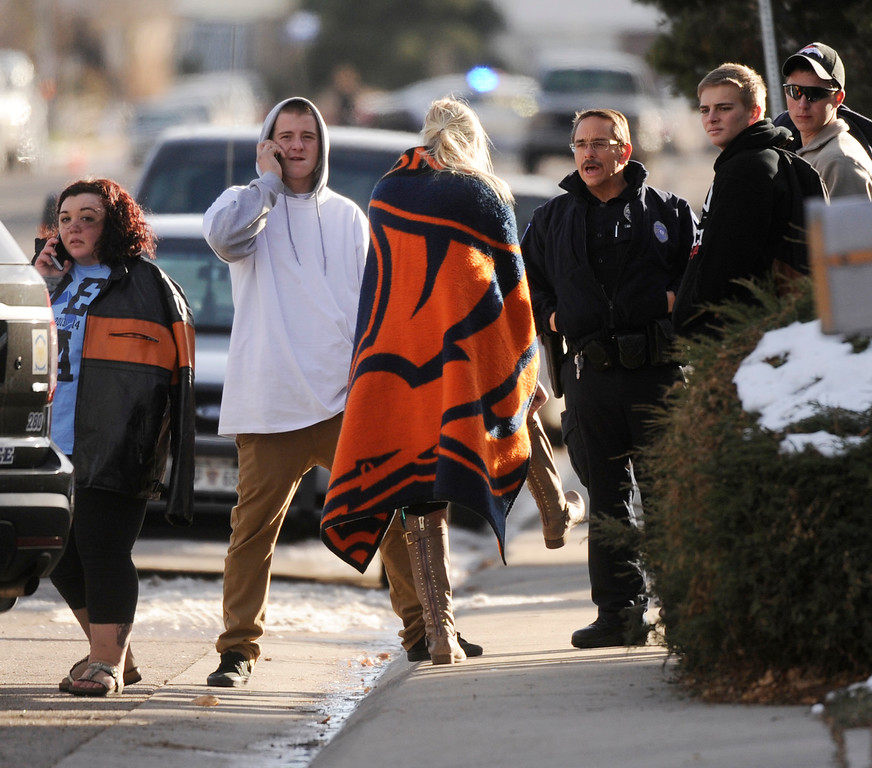 . CENTENNIAL, CO. - DECEMBER 13: Students waited to be reunited with their parents outside Arapahoe High School Friday afternoon, December 13, 2013. A former students with a shotgun inside the school sent hundreds of students rushing for safety. Photo By Karl Gehring/The Denver Post