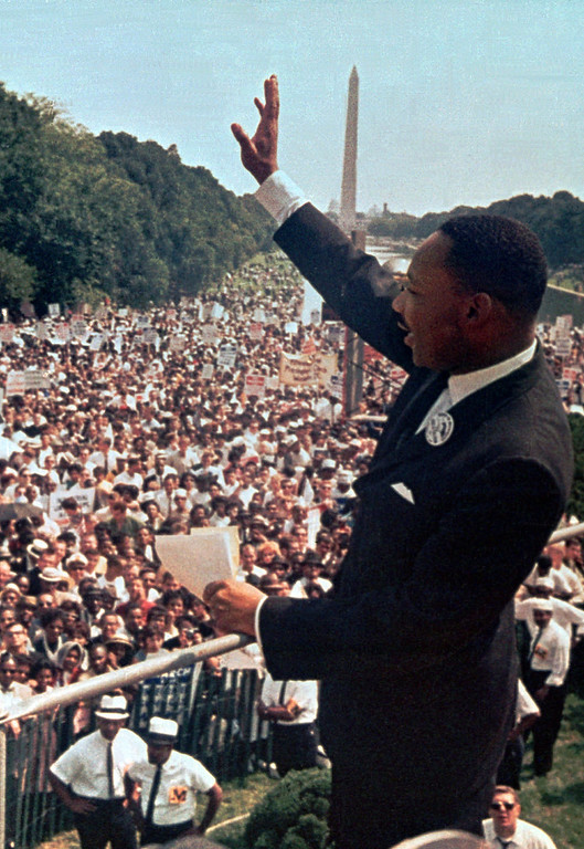 """. In this Aug. 28, 1963 file photo, The Rev. Martin Luther King Jr. waves to the crowd at the Lincoln Memorial for his \""""I Have a Dream\"""" speech during the March on Washington. The march was organized to support proposed civil rights legislation and end segregation. (AP Photo/File)"""