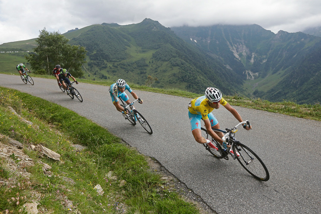 . Italy\'s Vincenzo Nibali, wearing the overall leader\'s yellow jersey, is followed by Spain\'s Alejandro Valverde, third left, Tejay van Garderen of the U.S., second left, and Netherlands\' Laurens ten Dam, far left,  during the seventeenth stage of the Tour de France cycling race over 124.5 kilometers (77.4 miles) with start in Saint-Gaudens and finish in Saint-Lary, France, Wednesday, July 23, 2014. (AP Photo/Laurent Cipriani)