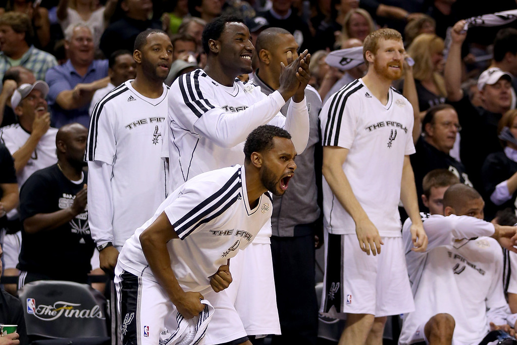 . Patty Mills #8 and DeJuan Blair #45 of the San Antonio Spurs celebrate from the bench in the second half while taking on the Miami Heat during Game Three of the 2013 NBA Finals at the AT&T Center on June 11, 2013 in San Antonio, Texas.   (Photo by Mike Ehrmann/Getty Images)