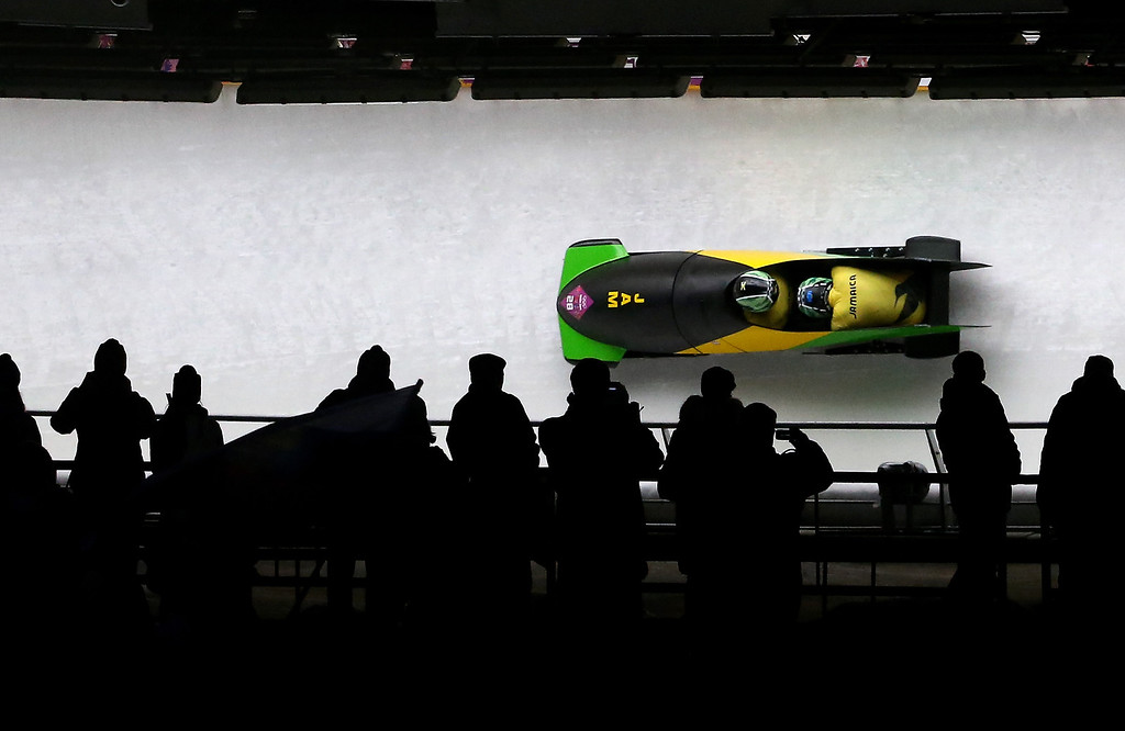 . Pilot Winston Watts and Marvin Dixon of Jamaica team 1  make a run during the Men\'s Two-Man Bobsleigh heats on Day 9 of the Sochi 2014 Winter Olympics at Sliding Center Sanki on February 16, 2014 in Sochi, Russia.  (Photo by Al Bello/Getty Images)