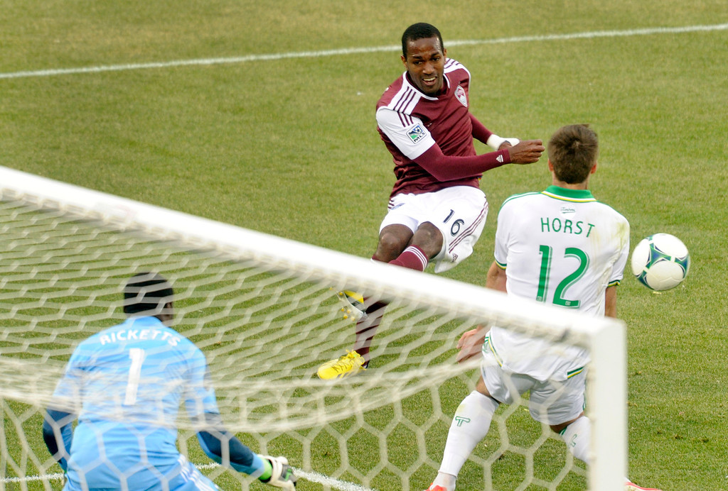 . Atiba Harris (16) of the Colorado Rapids tried to put a shot on net in the second half. The Colorado Rapids tied the Portland Timbers 2-2 Saturday, March 30, 2013 at Dick\'s Sporting Goods Park in Commerce City.  Photo By Karl Gehring/The Denver Post)