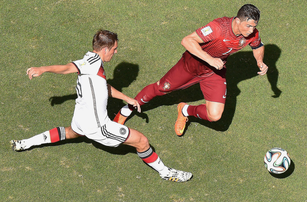 . Germany\'s defender and captain Philipp Lahm (L) tackles Portugal\'s forward and captain Cristiano Ronaldo during the Group G football match between Germany and Portugal at the Fonte Nova Arena in Salvador on June 16, 2014, during the 2014 FIFA World Cup.     FRANCOIS XAVIER MARIT/AFP/Getty Images