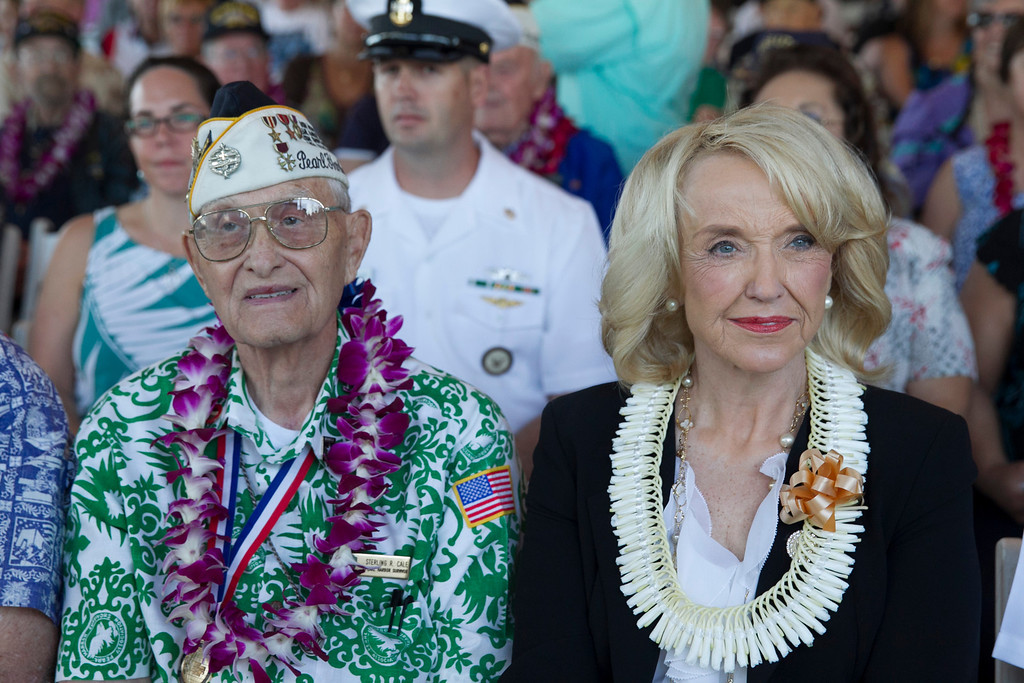 . Pearl Harbor survivor Sterling Cale, left, and Arizona Gov. Jan Brewer wait for the start of ceremony commemorating the 72nd anniversary of the attack on Pearl Harbor, Saturday, Dec. 7, 2013, in Honolulu.  (AP Photo/Marco Garcia)