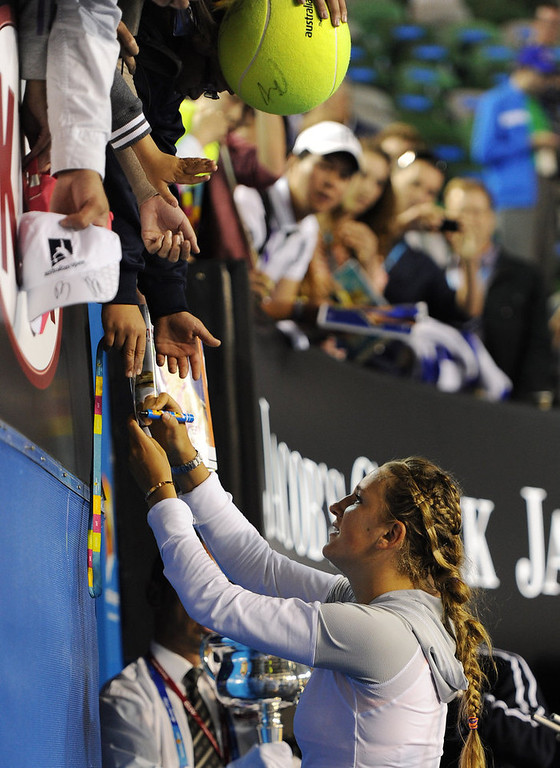 . Victoria Azarenka of Belarus signs autographs after winning the women\'s final at the Australian Open tennis championship in Melbourne, Australia, Saturday, Jan. 26, 2013. (AP Photo/Andrew Brownbill)