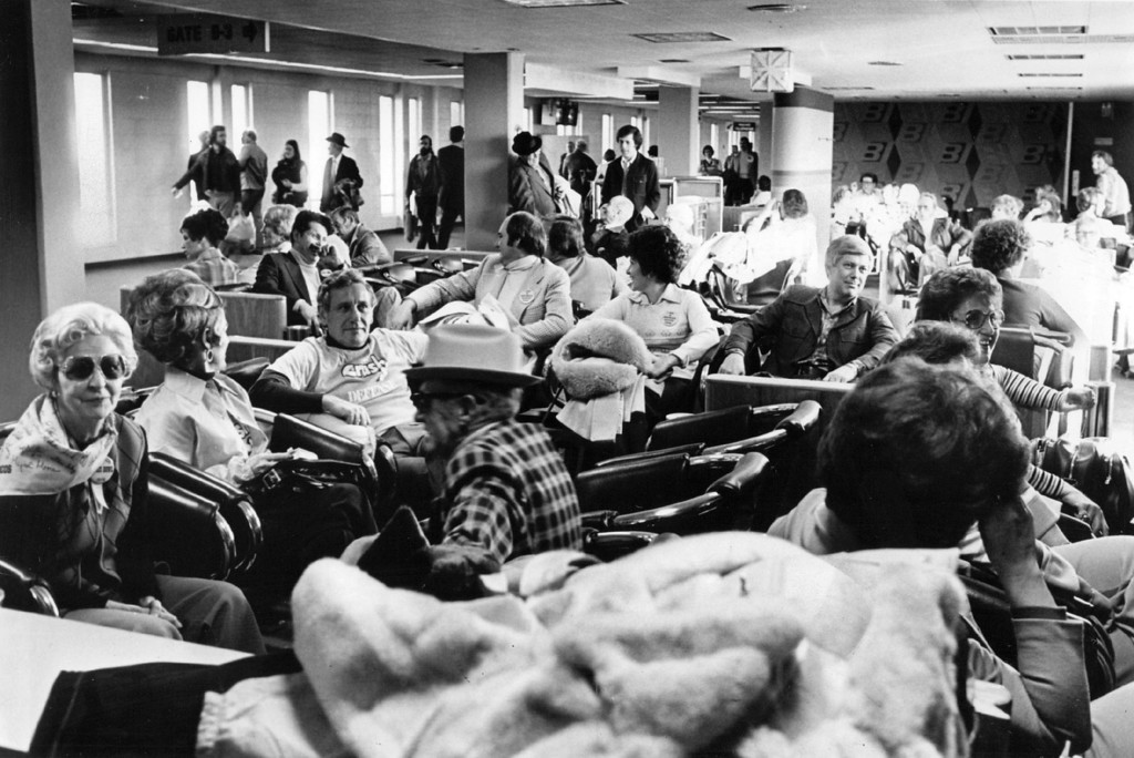 . JAN 14 1978 - Broncos fans at airport waiting for flight to new Orleans. Happy Denver Bronco fans don\'t appear to mind the wait for their Braniff charter flight to New Orleans and Sunday\'s Super Bowl. Joyful Coloradans were among about 800 who took direct flight Friday while another 300 rode indirect flights via Dallas. By noon Sunday, more than 10,000 Bronco fans will have taken commercial airlines to New Orleans for the Broncos\' game against Dallas. Braniff said it will move another 330 fans Saturday and 950 on seven direct flight between 2 a.m. and 11:20 a.m. Sunday. Continental Airlines said it will have flown 3,000 fans to New Orleans by noon Sunday directly and via Chicago, St. Louis, Houston and Dallas. Texas International Airlines is carrying a similar number while Frontier Airlines has carried many more as far as Dallas. (Ernie Leyba/The Denver Post)