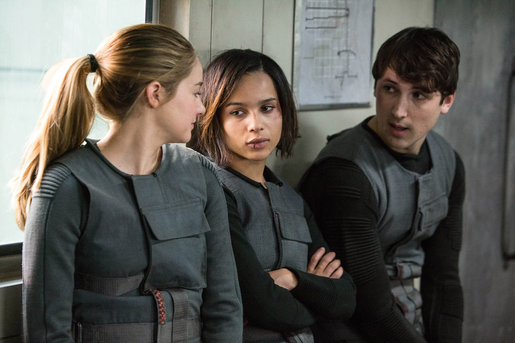 ". This image released by Summit Entertainment shows, from left, Shailene Woodley, Zoe Kravitz, and Ben Lloyd-Hughes in a scene from ""Divergent.\"" (AP Photo/Summit Entertainment, Jaap Buitendijk)"