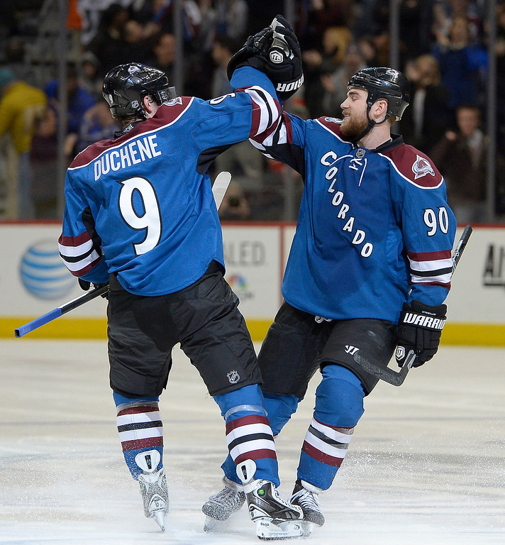 . DENVER, CO - JANUARY 16: Colorado Avalanche center Ryan O\'Reilly (90) celebrates his winning goal with Colorado Avalanche center Matt Duchene (9) after scoring on New Jersey Devils goalie Cory Schneider (35) during a shootout January 16, 2014 at Pepsi Center. Colorado Avalanche defeat the New Jersey Devils 2-1 in the shootout. (Photo by John Leyba/The Denver Post)