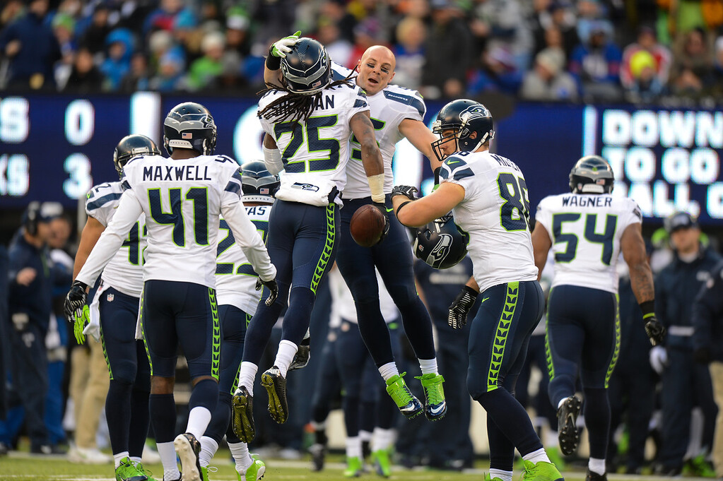 . Cornerback Richard Sherman #25 of the Seattle Seahawks celebrates after an interception in the 1st half against the New York Giants at MetLife Stadium on December 15, 2013 in East Rutherford, New Jersey. (Photo by Ron Antonelli/Getty Images)