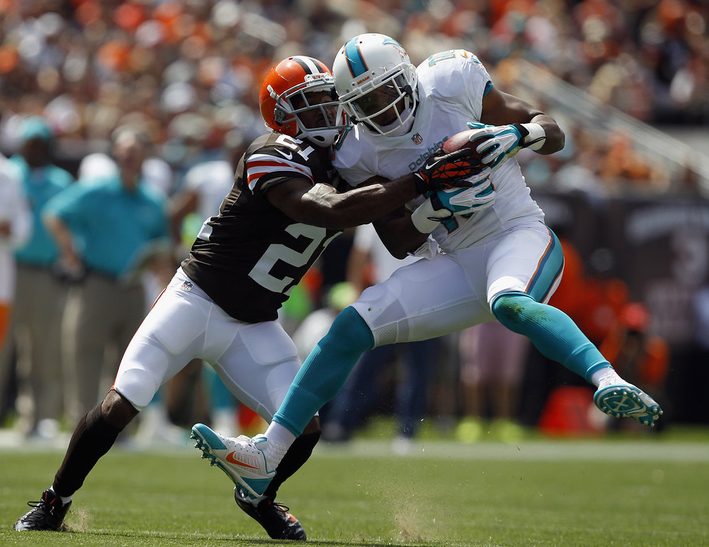 . Wide receiver Brandon Gibson #10 of the Miami Dolphins makes a catch in front of defensive back Chris Owens #21 of the Cleveland Browns at Cleveland Browns Stadium on September 8, 2013 in Cleveland, Ohio.  (Photo by Matt Sullivan/Getty Images)