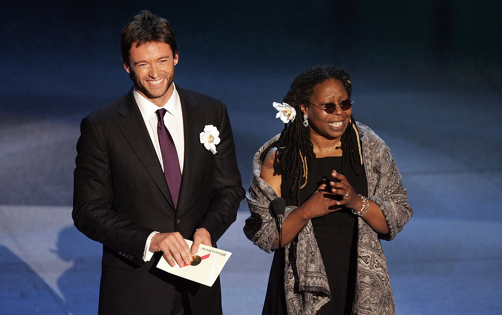 . Actor Hugh Jackman (L) and Actress Whoopi Goldberg present the award for Outstanding Comedy Series onstage at the 57th Annual Emmy Awards held at the Shrine Auditorium on September 18, 2005 in Los Angeles, California.  (Photo by Vince Bucci/Getty Images)
