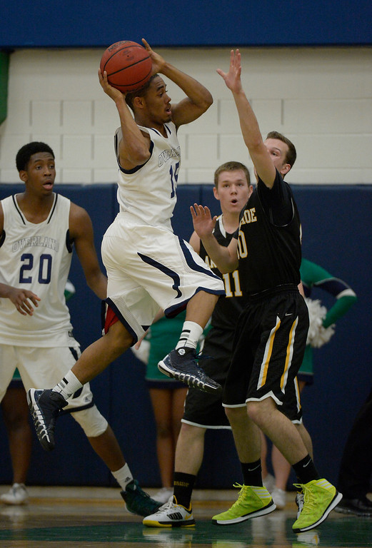 . AURORA, CO - FEBRUARY 12: Overland Austin Conway (15) flies through the air to make a pass on Arapahoe Corbin Atwell (10) during their 5A basketball game February 12, 2014 in Aurora. (Photo by John Leyba/The Denver Post)