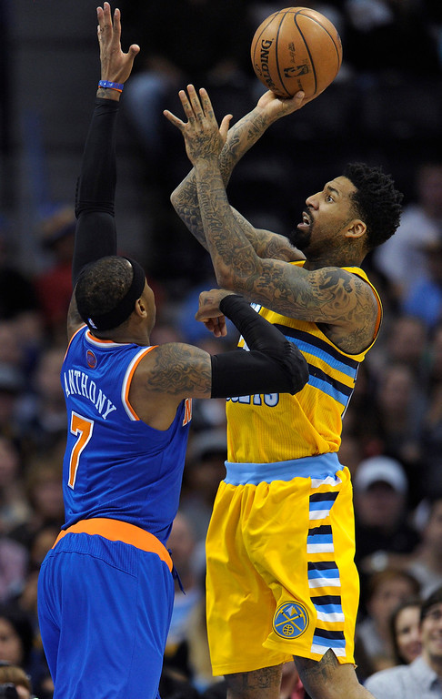 . Denver forward Wilson Chandler (21) took a look at the basket over New York defender Carmelo Anthony (7) in the first half.   Photo By Karl Gehring/The Denver Post